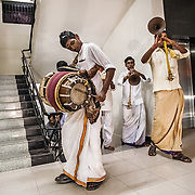 Musicians arrive at the wedding hall in Vashakapatnam. In some hindu wedding traditions, especially in south India and the east coast of the country, sounds like sneezing or cough are considered in-auspicious during the wedding. At important moments while reciting sacred mantras the pandit (priest) would single the band to play their music up in order to drown any such inauspicious noises. Andra Pradesh, 2009.