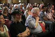 Attendees are observing a minute of inner focus during The Sunday Assembly (today held inside Conway Hall in central London), an atheist service founded by British comedians Sanderson Jones and Pippa Evans in 2013, in London, England. The gathering is designed to bring together non-religious people who want a similar communal experience to a religious church. Satellite assemblies have been established in over 30 cities including New York, San Diego, and Dublin.