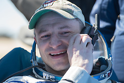 Expedition 62 astronaut Andrew Morgan is seen talking on the satellite phone outside the Soyuz MS-15 spacecraft after he landed with NASA astronaut Jessica Meir and Roscosmos cosmonaut Oleg Skripochka in a remote area near the town of Zhezkazgan, Kazakhstan on Friday, April 17, 2020. Meir and Skripochka returned after 205 days in space, and Morgan after 272 days in space. All three served as Expedition 60-61-62 crew members onboard the International Space Station.<br /> <br /> Where: Zhezkazgan, Kazakhstan<br /> When: 17 Apr 2020<br /> Credit: NASA/GCTC/Andrey Shelepin/Cover Images<br /> <br /> **Editorial use only**