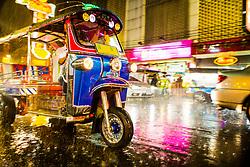 Tuk Tuk Speeding in the Rain in Downtown Bangkok at Night