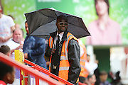 Steward with an umbrella and sun glasses during the EFL Sky Bet Championship match between Charlton Athletic and Bolton Wanderers at The Valley, London, England on 27 August 2016. Photo by Matthew Redman.