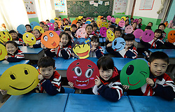 November 20, 2018 - Handan, Handan, China - Handan, CHINA-Pupils draw paintings of smiling faces at a primary school in Handan, north China's Hebei Province, marking the World Hello Day. The World Hello Day was begun in response to the conflict between Egypt and Israel in the Fall of 1973.  Since then, World Hello Day has been observed by people in 180 countries. (Credit Image: © SIPA Asia via ZUMA Wire)