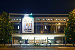 Night view of historic East German era Kino international on Karl Marx Strasse in Mitte Berlin, Germany