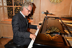 Songwriter, musician and record producer GUY CHAMBERS at a party to celebrate the publication of 'Let's Eat meat' by Tom Parker Bowles held at Fortnum & Mason, Piccadilly, London on 21st October 2014.