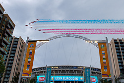 © Licensed to London News Pictures. 11/07/2021. London, UK. The Red Arrows, officially known as the Royal Air Force Aerobatic Team, fly over Wembley Stadium ahead of the EURO2020 football final against England and Italy. Photo credit: Peter Manning/LNP