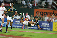 South Africa's Ryno Benjamin dives over to score his sides match winning try in the dying seconds to clinch a 19-12 win. IRB Emirates airline Dubai sevens 2008.cup  final match action between  South Africa and England  at the Sevens Stadium in Dubai on Sat 29th November 2008..pic by Andrew Orchard.  Andrew Orchard sports photography,