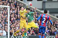 Timm Klose of Norwich City attempting to head the ball over Goalkeeper Wayne Hennessey of Crystal Palace. Barclays Premier League match, Crystal Palace v Norwich city at Selhurst Park in London on Saturday 9th April 2016. pic by John Patrick Fletcher, Andrew Orchard sports photography.