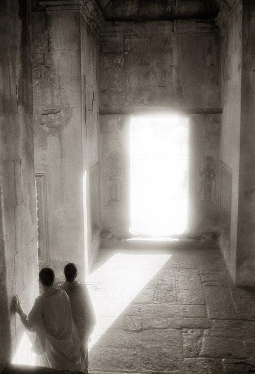 Monks in a Sunlit Doorway - Angkor Wat.