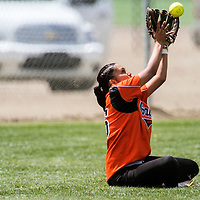 051113       Cable Hoover<br /> <br /> Gallup Bengal Richelle Yazzie (15) reaches to make a successful catch of a Goddard Rockets fly ball after stumbling and sitting down in the outfield during the first round of the state tournament at Gallup High School Saturday.
