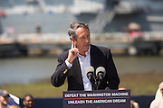 Congressmen and former Governor Mark Sanford gives his support to GOP presidential hopeful Senator Rand Paul at a campaign rally in front of the aircraft carrier USS Yorktown on April 9, 2015 in Mt Pleasant, South Carolina.  Paul outlined a foreign policy vision built both on a strong military and a commitment to use it sparingly.