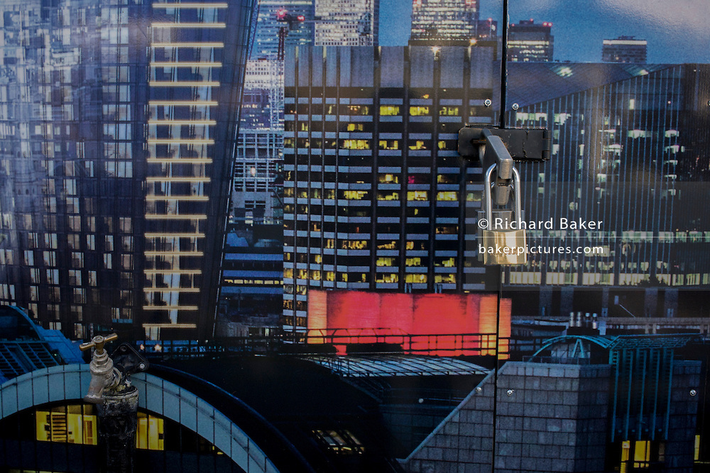 Padlock on Blackfriars property development marketing suite hoarding landscape, symbolising increasing private ownership of London's public urban space.
