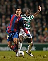 Photo. Jed Wee.Digitalsport<br /> Glasgow Celtic v Barcelona, UEFA Cup, Celtic Park, Glasgow. 11/03/2004.<br /> Celtic's Bobo Balde (R) goes in strongly to dispossess Barcelona's Thiago Motta.
