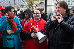 London, UK. 12 November, 2019. Ian Hodson, National President of the Bakers Food & Allied Workers Union (BFAWU) addresses McDonald's workers assembled opposite Downing Street during strike action, dubbed a 'McStrike', to call for a New Deal for McDonald's Workers which would include £15 an hour, an end to youth rates, the choice of guaranteed hours of up to 40 hours a week, notice of shifts four weeks in advance and union recognition.
