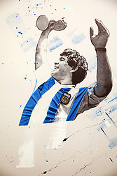 A piece featuring Argentina's Diego Maradona on display at the Art of Football World In Colour Exhibition Preview at Hoxton Arches, London.