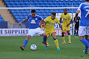 AFC Wimbledon midfielder Jake Reeves (8) and Peterborough United striker Paul Taylor (10) during the EFL Cup match between Peterborough United and AFC Wimbledon at ABAX Stadium, Peterborough, England on 9 August 2016. Photo by Stuart Butcher.