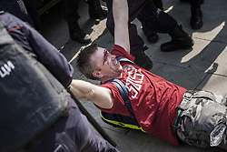 May 5, 2018 - Moscow, Russia - Wounded Navalny supporter is arrested by riot police in a demonstration in Pushkin square. Russians angered by the impending inauguration of Vladimir Putin to a new term as president demonstrated throughout the country on Saturday. Police responded by reportedly arresting more than 1,000 of them, including protest organizer Alexei Navalny, the anti-corruption campaigner who is Putin's most prominent foe. (Credit Image: © Celestino Arce via ZUMA Wire)