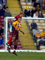Photo: Jed Wee.<br />Bradford City v Swansea City. Coca Cola League 1. 14/01/2006.<br />Swansea's Alan Tate jumps above Bradford's Joe Brown to win the ball.
