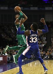 Boston Celtics' Marcus Smart shoots past Philadelphia 76ers' Robert Covington during the NBA London Game 2018 at the O2 Arena, London.