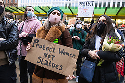 """© Licensed to London News Pictures. 20/03/2021. Manchester, UK. A woman holds up a placard reading """" Protect women not statues """" . Thousands attent a """" Kill the Bill """" and Reclaim the Streets protest demonstration in St Peter's Square in Manchester City Centre in opposition to the Police, Crime, Sentencing and Courts Bill 2021 that is currently before Parliament and after the death of Sarah Everard in London . Photo credit: Joel Goodman/LNP"""