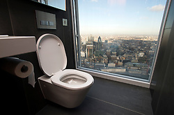 **PICTURES STRICTLY EMBARGOED INTIL 00:01 HOURS FRIDAY 11 JANUARY 2013** © London News Pictures. London, UK.  A view from a toilet showing the London Skyline during a media preview of the viewing level of The Shard building in London ahead of the public opening of 'A View From The Shard' on February 1, 2013. The public can view a 360 degree view of the capital from the 72nd floor of Western Europe's tallest building which stands at 800ft (244m).  Photo credit : Ben Cawthra/LNP