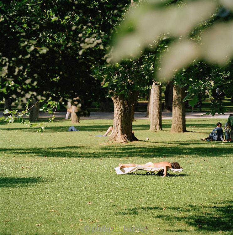 People relaxing and sunbathing in a park in Oviedo, Asturias, Spain