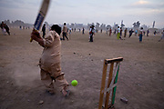 Playing cricket in Iqbal park, Lahore, Pakistan