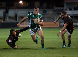 Benetton Treviso's Alberto Sgarbi evades the tackle of Dragons' Gavin Henson<br /> <br /> Photographer Simon King/Replay Images<br /> <br /> Guinness PRO14 Round 1 - Dragons v Benetton Treviso - Saturday 1st September 2018 - Rodney Parade - Newport<br /> <br /> World Copyright © Replay Images . All rights reserved. info@replayimages.co.uk - http://replayimages.co.uk
