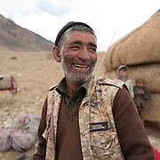 "Portrait of Noor Mohammed, our donkey wrangler. Camp at a Wakhi high pasture names ""Warm"", below Garumdee Pass. Guiding and photographing Paul Salopek while trekking with 2 donkeys across the ""Roof of the World"", through the Afghan Pamir and Hindukush mountains, into Pakistan and the Karakoram mountains of the Greater Western Himalaya."