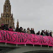 London, England, UK. 11th December 2018: Activists holding a big banner across Westminster bridge to protest of the convictions of Stansted 15 to be drop for protesting to end the brutal deportation flights, inhumane indefinite detention, and the hostile environment. #Stansted15