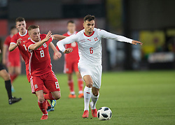NEWPORT, WALES - Tuesday, October 16, 2018: Switzerland's Nedim Bajrai in action against Wales' Joseff Morrell during the UEFA Under-21 Championship Italy 2019 Qualifying Group B match between Wales and Switzerland at Rodney Parade. (Pic by Laura Malkin/Propaganda)