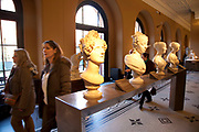 Visitors in the Sculptire galleries. The Victoria and Albert Museum aka the V&A at South Kensington, London. Known as the world's greatest museum of art and design, with collections unrivalled in their scope and diversity. Discover 3000 years' worth of amazing artefacts from many of the world's richest cultures including ceramics, furniture, fashion, glass, jewellery, metalwork, photographs, sculpture, textiles and paintings.