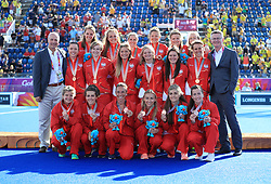 England Hockey players are presented with their Bronze medals at the Gold Coast Hockey Centre during day ten of the 2018 Commonwealth Games in the Gold Coast, Australia.