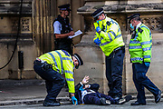 Extinction Rebellion activists, co-founder and spokesperson Robin Boardman who glued themselves in front of the Peers Gate, outside Westminster Palace of the Houses of Parliament, is handcuffed and is being taken by the Police, Thursday, Sept 3, 2020. Environmental non-violent activists group Extinction Rebellion enters its 3rd day of continuous ten days to disrupt political institutions throughout peaceful actions swarming central London into a standoff, demanding that central government obeys and delivers Climate Emergency bill.