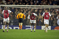 Arsenal players,Vieira,Campbell and Pires show their dejection after Chelsea's 2nd and winning goal. Arsenal v Chelsea. UEFA Champions League 1/4 Final 2nd leg @ Highbury. Credit :Andrew Cowie, Digitalsport