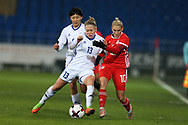 Svetlana Bortnikova of Kazakhstan (13) tackles Jessica Fishlock of Wales (10).Wales Women v Kazakhstan Women, 2019 World Cup qualifier match at the Cardiff City Stadium in Cardiff , South Wales on Friday 24th November 2017.    pic by Andrew Orchard