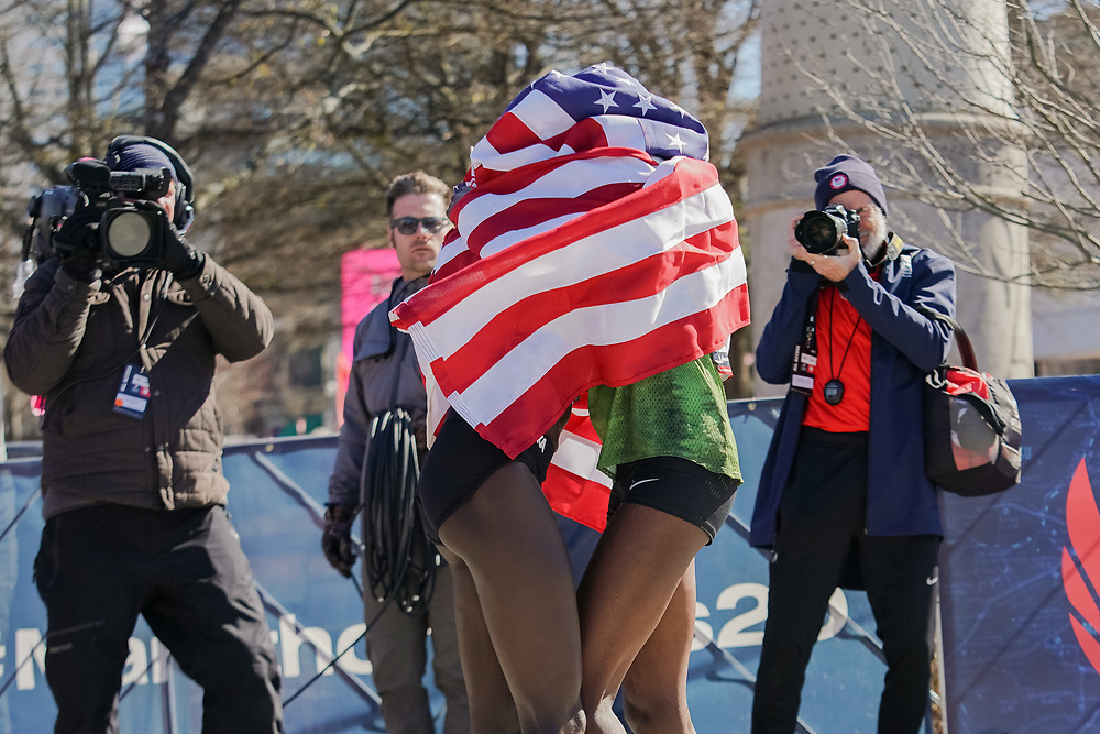 Sally Kipyego (right) celebrates with Aliphine Tuliamuk in the 2020 U.S. Olympic marathon trials in Atlanta on Saturday, Feb. 20, 2020. Kipyego finished third and Tuliamuk finished first. Photo by Kevin D. Liles for The New York Times