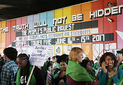 People congregate ahead of a silent walk by The Wall of Truth near Grenfell Tower, to mark one year since the blaze which claimed 72 lives.