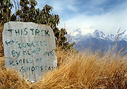 The Annapurna Circuit and Jomsom Treks are two of the most popular treks in the Nepal Himalaya. This sign provides teh perfect foreground for the majestic Dhaulagiri peak in the distance.