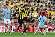 Troy Deeney (9) of Watford on the attack during the The FA Cup Final match between Manchester City and Watford at Wembley Stadium, London, England on 18 May 2019.
