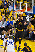 Cleveland Cavaliers forward Kevin Love (0) dunks over the Golden State Warriors during Game 2 of the NBA Finals at Oracle Arena in Oakland, Calif., on June 4, 2017. (Stan Olszewski/Special to S.F. Examiner)
