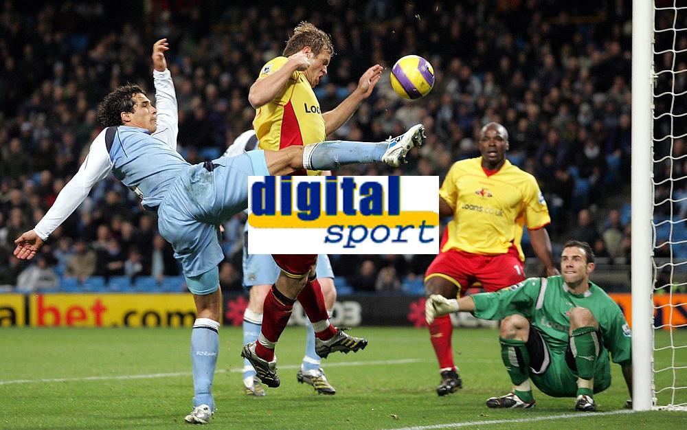 Photo: Paul Thomas.<br /> Manchester City v Watford. The Barclays Premiership. 04/12/2006.<br /> <br /> Bernardo Corradi of Man City (L) shoots for goal after a saved shot by Watford keeper Richard Lee (Green) from Joey Barton's free kick.