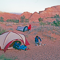 CAMPING. Backpackers set up camp in Arches National Park, Utah.