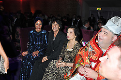 Left to right, ANA ARUAJO, RONNIE WOOD and BIANCA JAGGER at a party hosted by Roberto Cavalli to celebrate his new Boutique's opening at 22 Sloane Street, London followed by a party at Battersea Power Station, London SW8 on 17th September 2011.