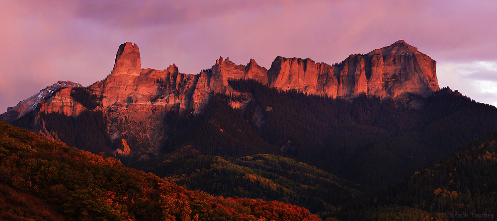 Alpenglow lights Chimney Rock and Courthouse Mountain in the San Juans of Southwest Colorado.