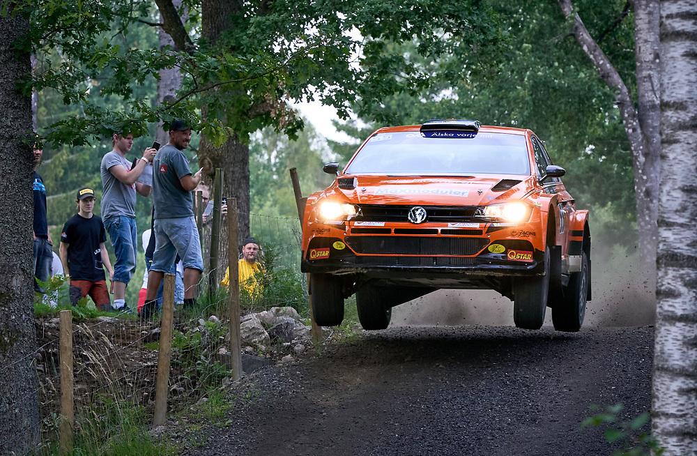 2021-07-16 MILLESBYGDEN<br /> <br /> Svenskt Mästerskap Rally-Sprint grus <br /> <br /> Dennis Rådström med codrivern Johan Johansson, båda KAK Motorsport, vann samtliga av kvällens tre sträckor när premiären av Grus-SM avgjordes i Millebygden, utanför Älmhult , där rallyduon fanns på plats med sin VW Polo R5.<br /> <br /> – Allt har gått fint idag, hälsar Dennis Rådström som vann totalt med 12,9 sekunder ner till tvåan Christoffer Haglund/Mathias Bengtsson. <br /> <br /> <br />  ***betalbild***<br /> <br /> Foto: Peo Möller<br /> <br /> rally, SM, Millesbygden, Dennis Rådström, Rådström Motorsport
