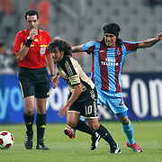 Trabzonspor's Gustavo COLMAN (R) and Benfica's Pablo AIMAR (L) during their UEFA Champions League third qualifying round, second leg, soccer match Trabzonspor between Benfica at the Ataturk Olimpiyat Stadium at İstanbul Turkey on Wednesday, 03 August 2011. Photo by TURKPIX