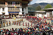 Performing a Rigsar dance at the Black-necked Crane festival at Gangte Goemba, Phobjikha Valley, Bhutan. Every year on November 11th, the local community hosts the Black-necked Crane festival at Gangtey Goenpa, to highlight its significance to the valley. Phobjikha Valley is the most significant overwintering ground of the rare and endangered Black-necked Crane in Bhutan.