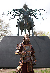 © licensed to London News Pictures. London, UK. 14/04/2012. A man dressed as Genghis Khan poses at the unveiling of a sculpture of Genghis Khan at Marble Arch in central London on April 14, 2012. The sculpture is by Dashi Namakov. Photo credit: Tolga Akmen/LNP