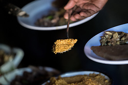 31 January 2019, Southern Nations, Nationalities, and Peoples' Region, Ethiopia: A traditional meal is served at Ato Kassa's farm in Hadiya, south central Ethiopia. Ato Kassa's farm is a model farm in the EECMY project in Lemo Community. 20 other farmers learn from the practices developed and implemented at Ato Kassa's farm, with support from the EECMY. Through the Mekane Yesus Food Security Project for Lemo Community, the Ethiopian Evangelical Church Mekane Yesus' development wing Development and Social Services Commission helps women raise their socio-economic status through community banking efforts and education, and helps improve communities' food security through training in agricultural methods suitable in a changing climate.