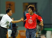 "11/08/04 - THESSALONIKI - GREECE -  -  FOOTBALL OLYMPIC MENS  -  First round Groupe A - <br />GREECE (2) V.s KOREA (2) at  THESSALONIKI ""KAFTATZOGLIO STADIUM"" <br />Korean N*13 KIM Dong Jin celebrating with head coach KIM Ho Kon, his goal. the first of the match.<br />© Gabriel Piko / Piko-Press"